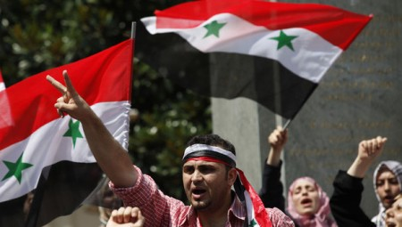 Syrian opposition demonstrators living in Turkey shout slogans during a protest against Syria